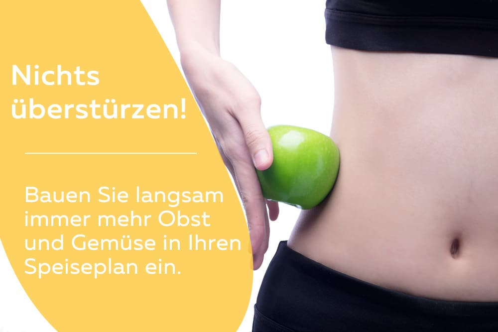 schlanke Frau mit Apfel