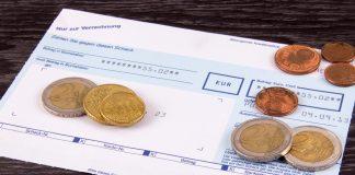 Verrechnungsscheck Exemplar Geld